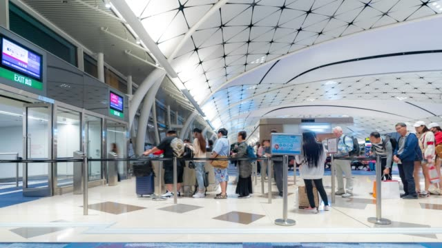 Time-lapse: Traveler Tourist boarding at gate in Hong Kong Airport 4K Time-lapse: Time-lapse: Traveler Tourist boarding at gate in Hong Kong Airport, Apple ProRes 422 (HQ) 3840x2160 Format customs stock videos & royalty-free footage