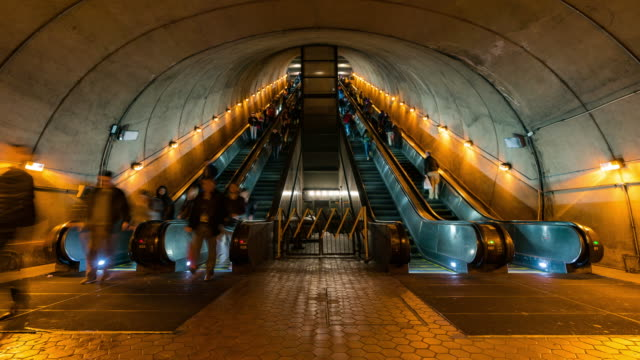 time-lapse: traveller pedestrian crowded at escalator in subway metro station in washington dc usa - escalator video stock e b–roll