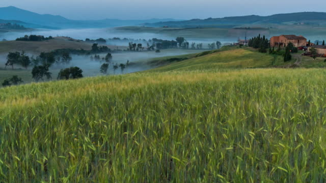 Time-lapse Tuscany landscape in Italy, morning with sunrise low fog, rice fields