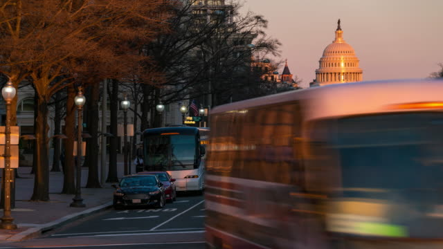 Time-lapse: US Capitol Building with transportation light from Freedom Square in Washington DC, USA at sunset twilight