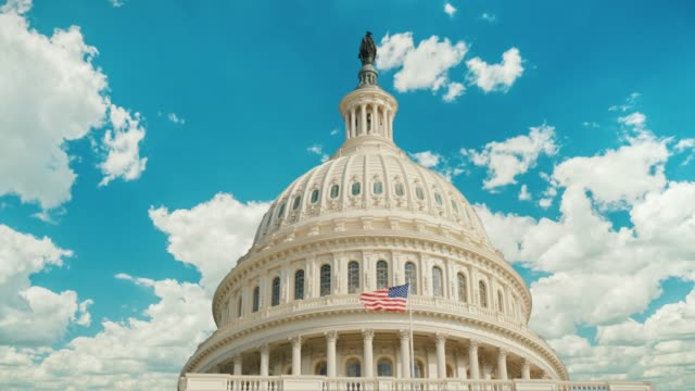 Timelapse video: Capitol building in Washington, DC. Clouds are swiftly floating on the building