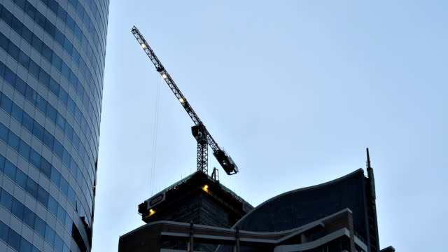 Timelapse video of crane in construction site video