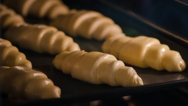 timelapse video of croissant baking in oven. - cucina francese video stock e b–roll