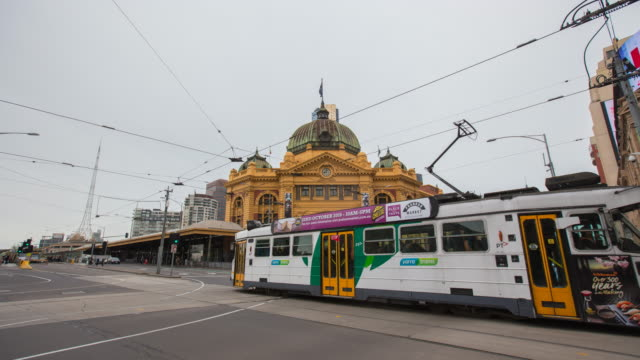 timelapse video of flinders street station - travel agent stock videos and b-roll footage