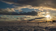 istock Timelapse video of ice fishing in Canada at sunset. 1185762259