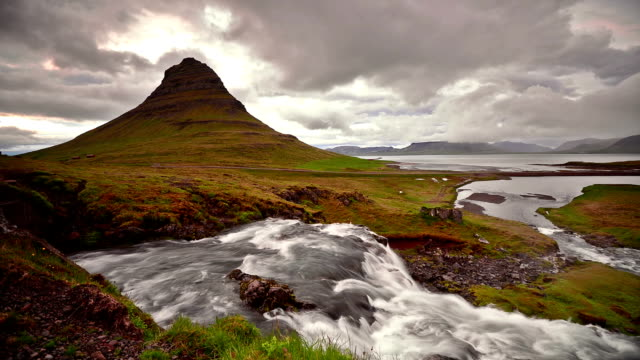 Timelapse video of Moving cloud and water at twilight, Kirkjufell, video