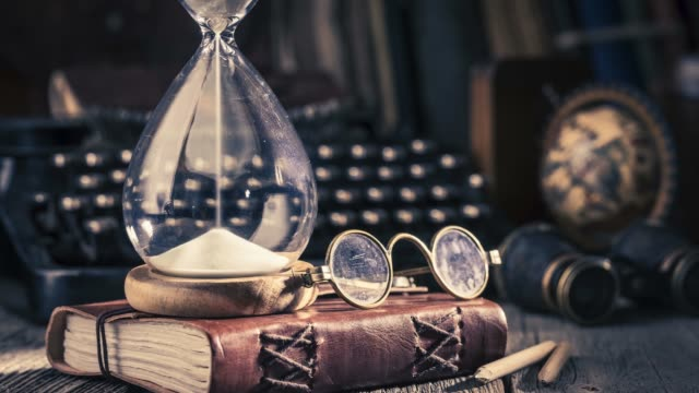 timelapse video of pouring sand in an hourglass - memories stock videos & royalty-free footage