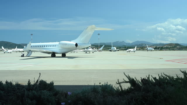 Time-lapse video of some private and commercial aircraft that depart and land in the Olbia airport, Sardinia, Italy. Time-lapse video of some private and commercial aircraft that depart and land in the Olbia airport, Sardinia, Italy. private airplane stock videos & royalty-free footage
