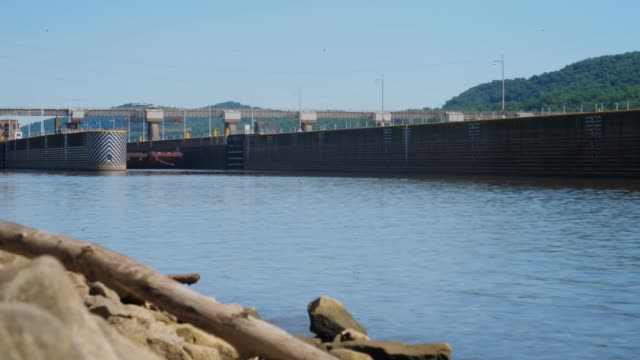 Timelapse View of Coal Barge Exiting Lock and Dam on Ohio River video