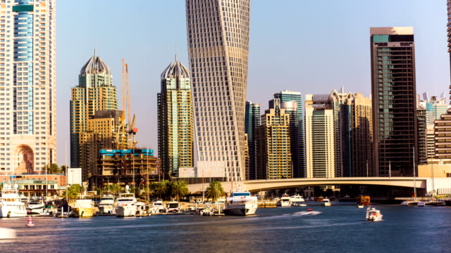 Timelapse view of Dubai Marina skyscrapers with floating yachts and boats , United Arab Emirates video