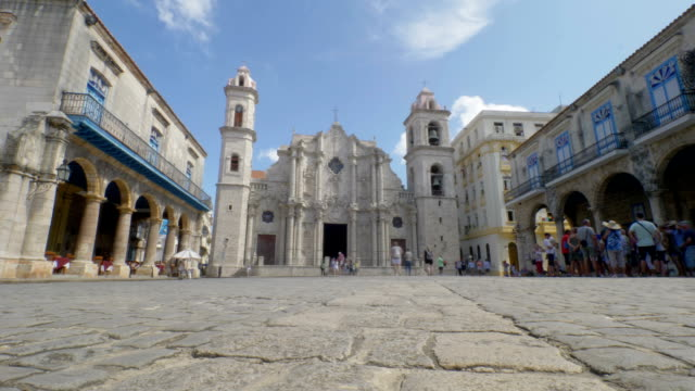 Timelapse View of Plaza de la Catedral in Havana Cuba HAVANA, CUBA - Circa July, 2017 - A low angle timelapse establishing shot of tourists visiting Cathedral Plaza Square in the old town district of Havana. cathedrals stock videos & royalty-free footage
