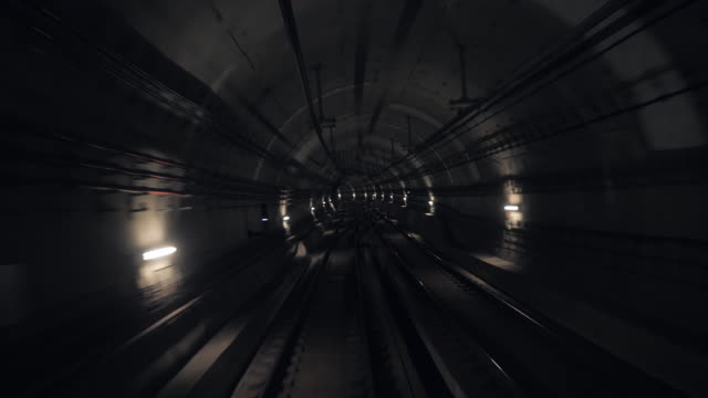 Timelapse View of subway tunnel from the rear of moving backward train. Fast underground train riding in tunnel of modern city.Long footage of underground train in Barcelona following its route. 4k Timelapse View of subway tunnel from the rear of moving backward train. Fast underground train riding in tunnel of modern city.Long footage of underground train in Barcelona following its route. 4k car transporter stock videos & royalty-free footage