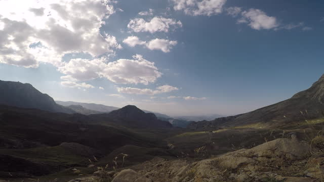 Timelapse view of the bulls from the plain between two hills.