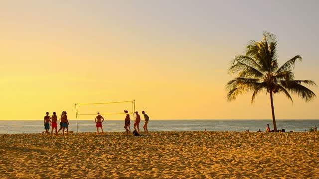 Timelapse volleyball on sunset beach video