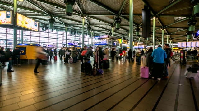 stockvideo's en b-roll-footage met hd time-lapse zoom out: traveler airport station terminal schiphol amsterdam netherlands - schiphol
