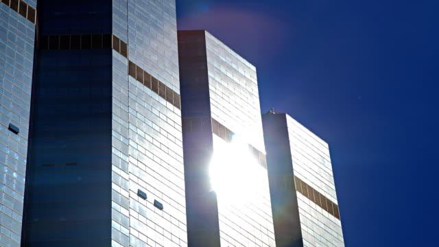 HD Timelapse:Sunlight reflective glass of a skyscraper.(zoom in) video