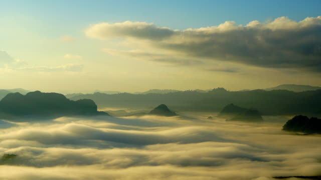 time-lapse.sunrise  moving fog on the mountain. - monsone video stock e b–roll