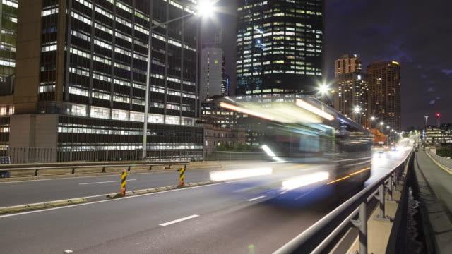 Timelaspe Footage of Traffic against office buildings