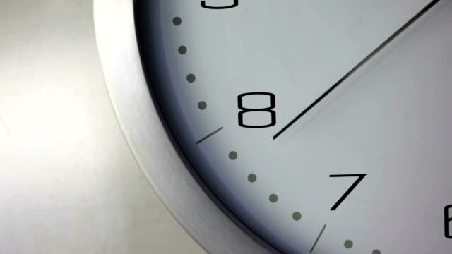 Timer    TI Close up dolly video clip of ticking clock focusing on second-counting hand, at natural speed passing from 6 round to 12 as it marks out time. wall clock stock videos & royalty-free footage