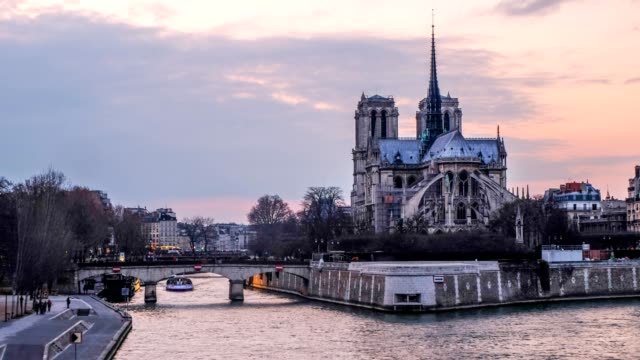 times-lapse notre dame at the river seine during twilight, paris, france - paris fashion stock videos and b-roll footage