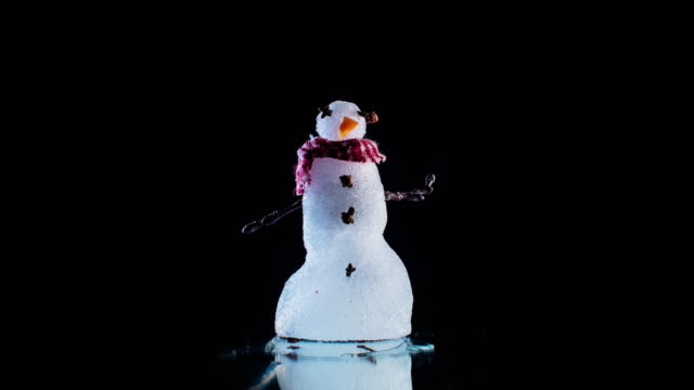 Tiny Melting Snowman on Black Time Lapse video