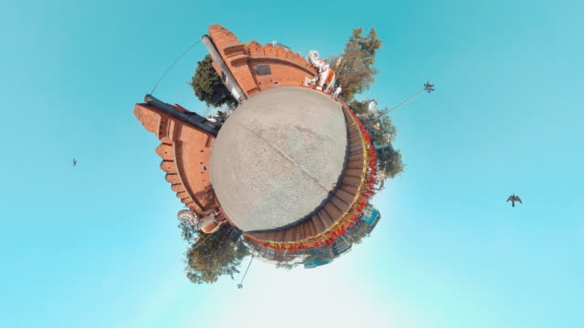 Tiny planet 360 view of famouse place Tha Phae Gate antique brick wall landmark in chiang mai