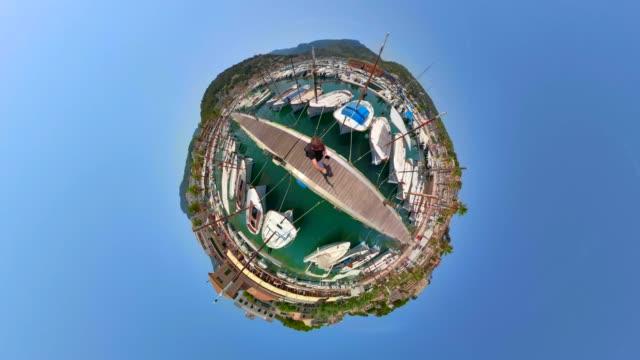 Tiny Planet view of Sailboat moorings in the harbor - Marina from Port de Soller  - Balearic Islands Majorca / Spain video