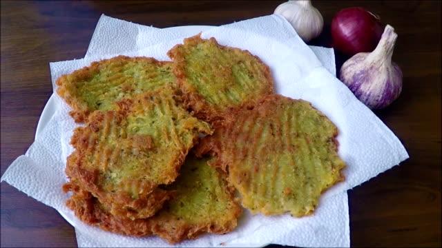 Tiny potato pancakes on plate video