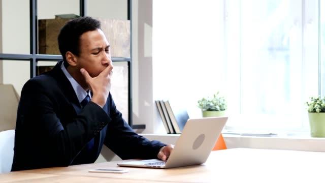 Tired Black Businessman Working on Laptop video