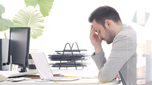 Tired businessman in office video