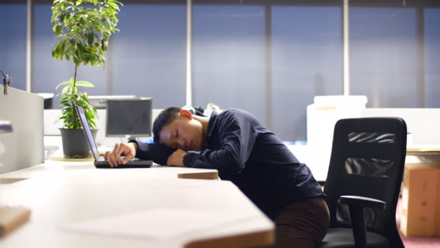 Tired businessman in the office video