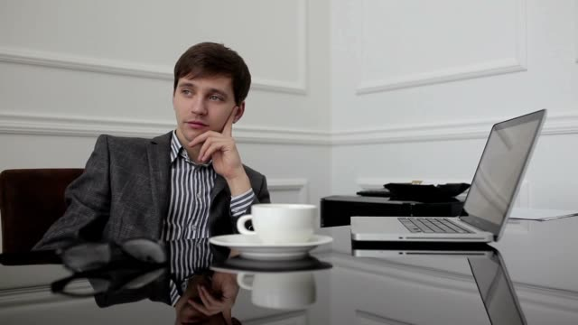 Tired man thinking over the work. video
