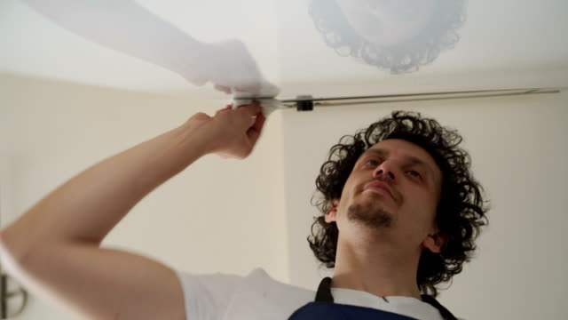 Tired men cleaning a house video