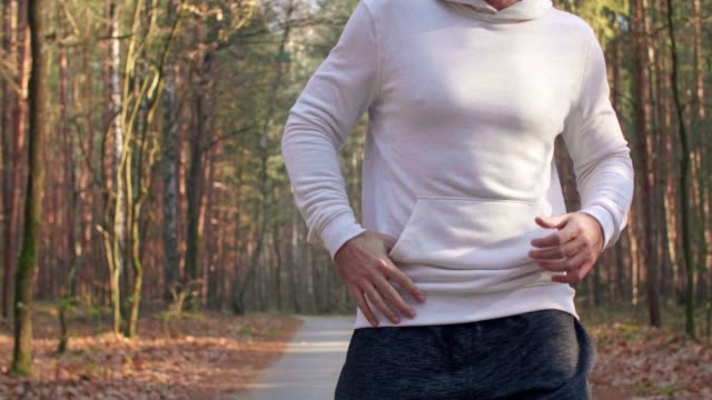 Tired runner suffering from cramp Tired runner suffering from cramp sportsperson stock videos & royalty-free footage