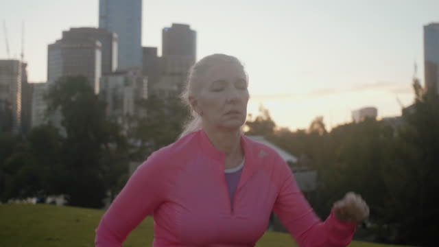 Tired senior runner (slow motion) Authentic series of senior fitness in Melbourne 50 59 years stock videos & royalty-free footage