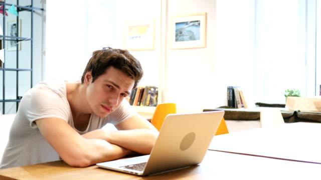 Tired Sleeping Man on Desk video