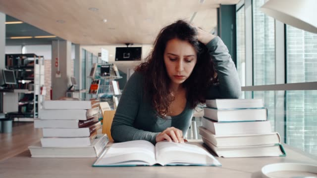 Tired student in library video