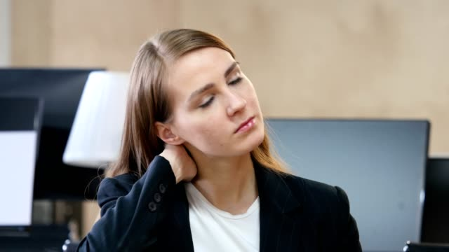 Tired Woman in Office with Neck Pain video