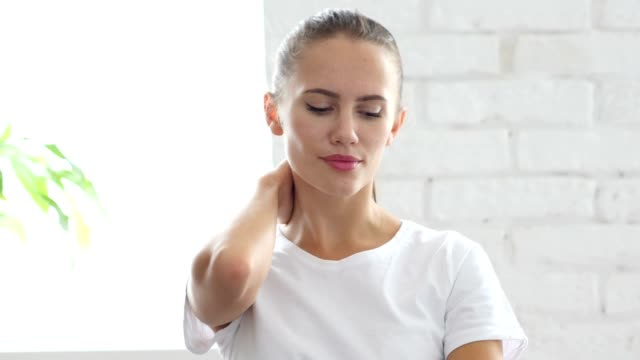 Tired Woman Relaxing Her Neck Muscles at Work, Portrait video