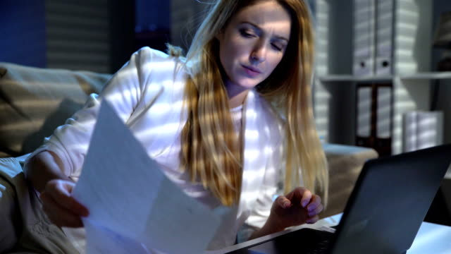 Tired young businesswoman suddenly wakes up and feverishly working in the office with laptop Tired young businesswoman suddenly wakes up and feverishly working in the office with laptop at night. life balance stock videos & royalty-free footage