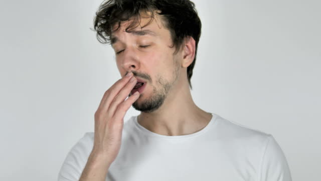 Tired Young Casual Man Yawning on White Background Tired Young Casual Man Yawning on White Background yawning stock videos & royalty-free footage