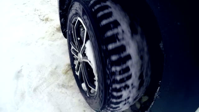 Tires, wheels driving through heavy snow. Slow motion. On board camera. video