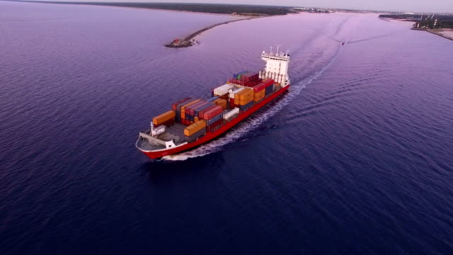HD - To follow the cargo ship. Aerial view video