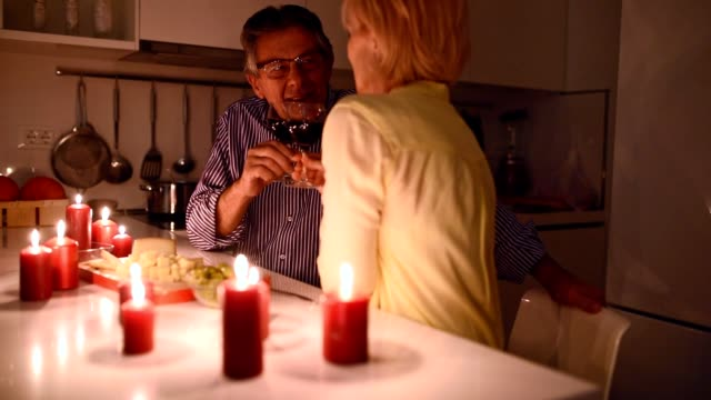Toast to you darling! Senior couple toasting to their love. date night romance stock videos & royalty-free footage