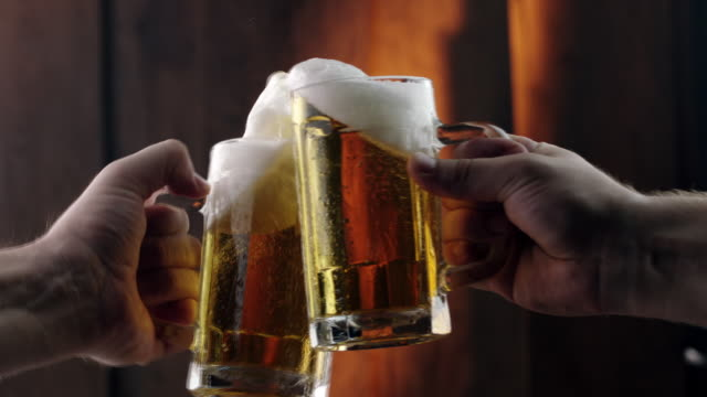 toasting with beer mugs - birra video stock e b–roll