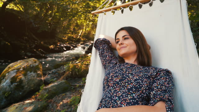 today is about relaxation. - woman portrait forest video stock e b–roll