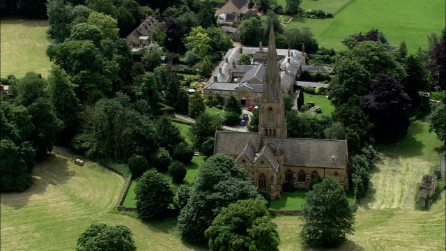 toddington church - aerial view - england,  gloucestershire,  tewkesbury helicopter filming,  aerial video,  cineflex,  establishing shot,  united kingdom - england stock videos & royalty-free footage