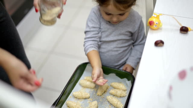 toddler baking with mother - french food stock videos and b-roll footage