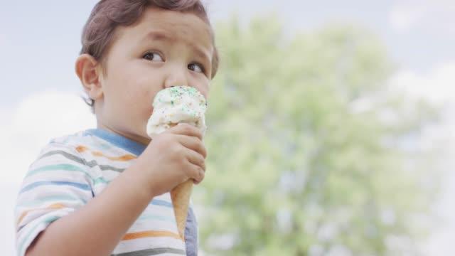 toddler eating ice cream - ice cream video stock e b–roll