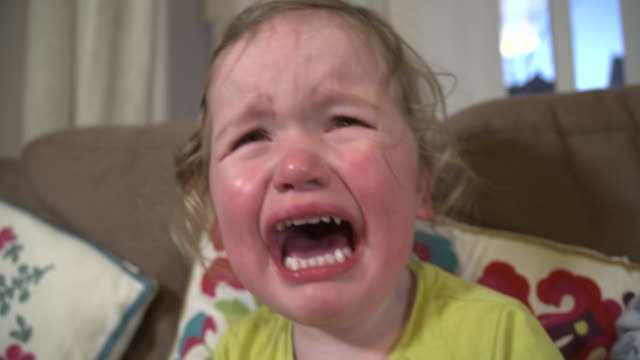 Toddler girl crying with mouth wide open and tears down her face video
